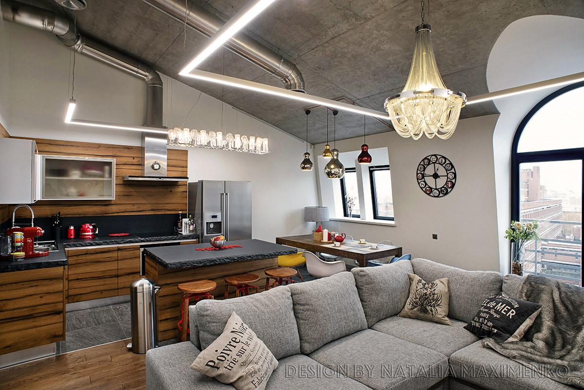Деревянный пол, уютный текстиль, дизайнерский свет привнесли в интерьер теплоту и уют.